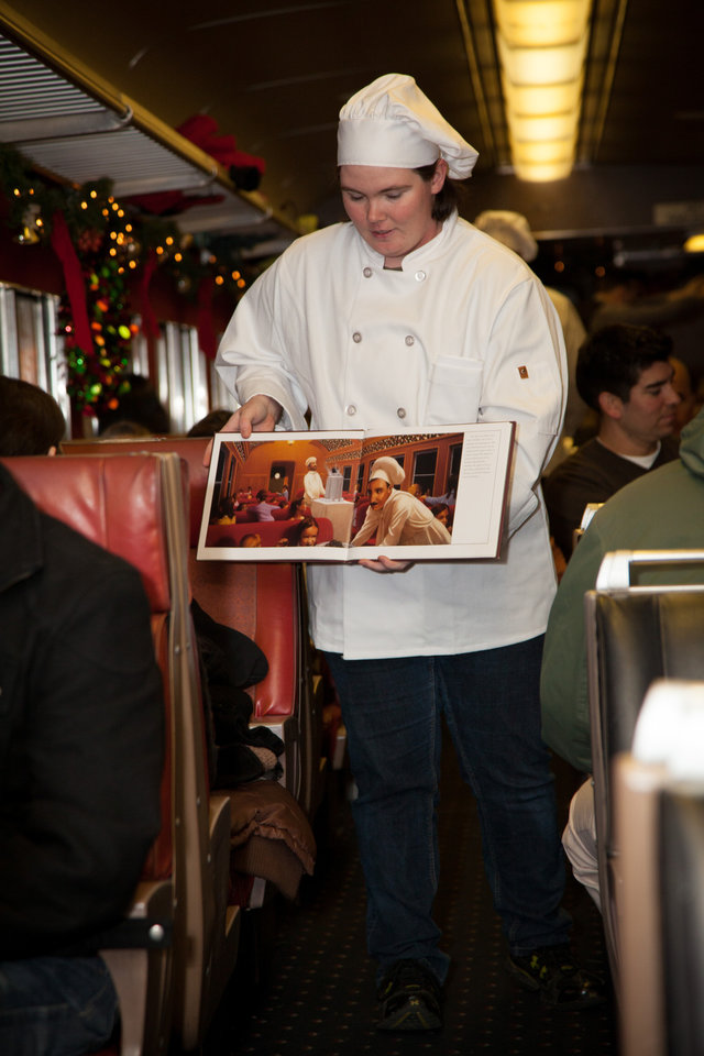 Photo a cast member dressed as a chef reads chris van allsburg s