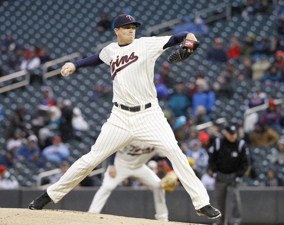 Photo - Minnesota Twins starting pitcher Kyle Gibson delivers to the Los Angeles Dodgers during the first inning of a baseball game in Minneapolis, Wednesday, April 30, 2014. (AP Photo/Ann Heisenfelt)