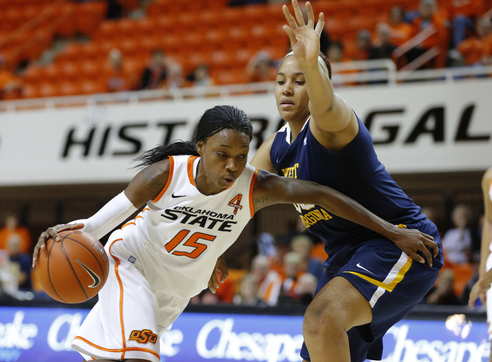 Oklahoma State's Toni Young (15) tries to get past West Virginia's Ayana Dunning (33) during a women's college basketball game between Oklahoma State and West Virginia at Gallagher-Iba Arena in Stillwater, Okla.,  Tuesday, Jan. 29, 2013. West Virginia won 67-61. Photo by Bryan Terry, The Oklahoman