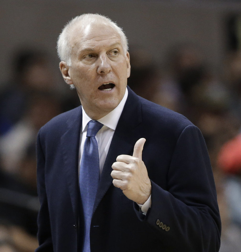 Photo - San Antonio Spurs coach Gregg Popovich signals to his team during the first half of an NBA basketball game against the Denver Nuggets, Wednesday, March 27, 2013, in San Antonio. The Spurs won 100-99. (AP Photo/Eric Gay) ORG XMIT: TXEG114