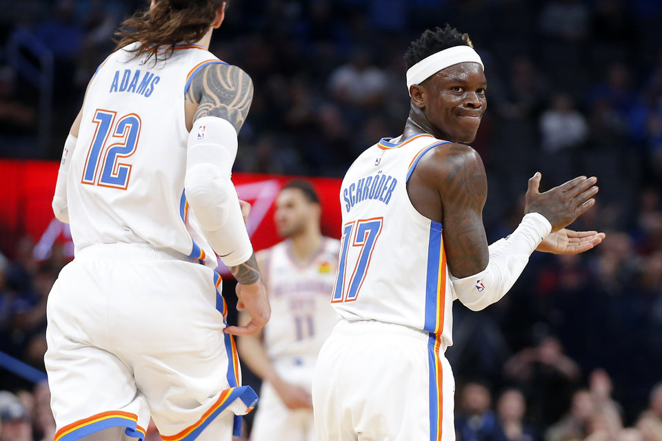 Photo - Oklahoma City's Dennis Schroder (17) claps during an NBA basketball game between the Oklahoma City Thunder and the Cleveland Cavaliers at Chesapeake Energy Arena in Oklahoma City, Wednesday, Feb. 5, 2020. Oklahoma City won 109-103. [Bryan Terry/The Oklahoman]