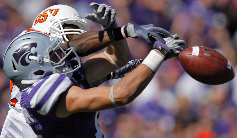 Kansas State's Ty Zimmerman (12) breaks up a pass for Oklahoma State's Isaiah Anderson (82) during the second half of the college football game between the Oklahoma State University Cowboys (OSU) and the Kansas State University Wildcats (KSU) on Saturday, Oct. 30, 2010, in Manhattan, Kan.   Photo by Chris Landsberger, The Oklahoman