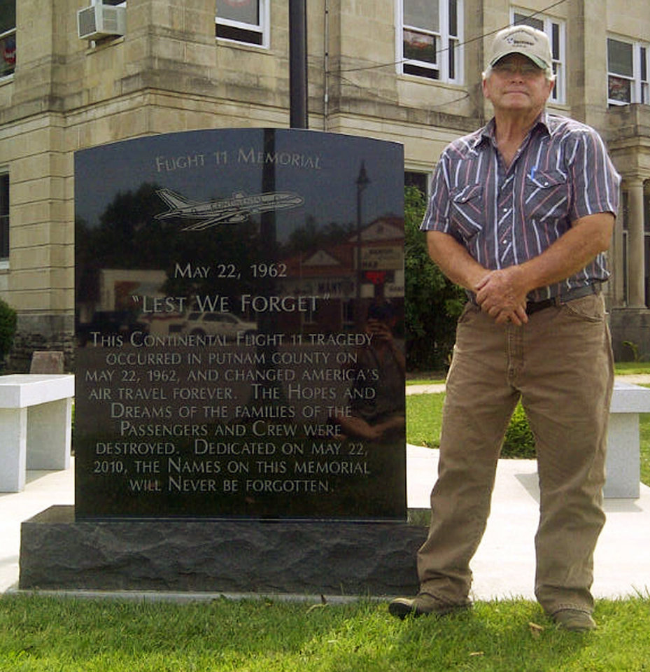 Photo -   This June 6, 2012 photo shows Ronnie Cook, a northern Missouri farmer, next to a memorial honoring the crew and passengers of Continental Flight 11 in Unionville, Mo. Cook was a high school junior when the plane crashed on on May 22, 1962, and was among the first on the scene when the plane went down 50 years ago. All 45 people aboard died after passenger Thomas Doty detonated six sticks of dynamite as part of a botched insurance fraud scam. (AP Photo/Alan Scher Zagier)