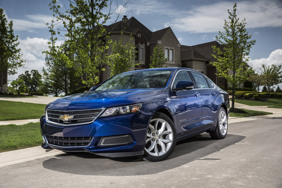Photo - This undated photo made available by General Motors shows the 2014 Chevrolet Impala 2.5L iVLC. (AP Photo/GM)