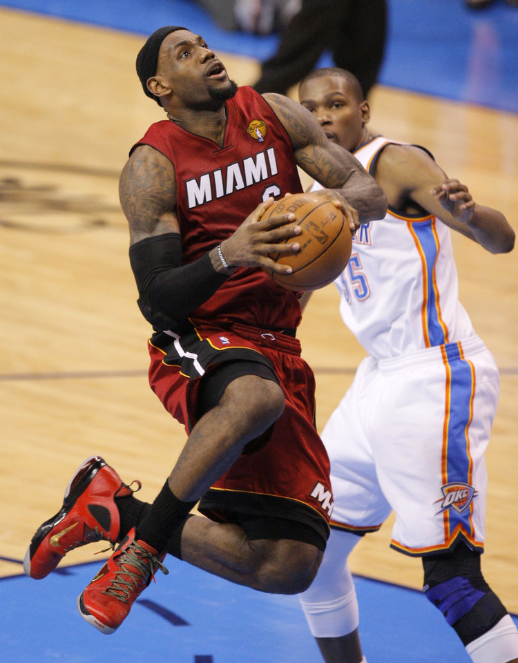 Miami's LeBron James (6) goes past Oklahoma City 's Kevin Durant (35) during Game 1 of the NBA Finals between the Oklahoma City Thunder and the Miami Heat at Chesapeake Energy Arena in Oklahoma City, Tuesday, June 12, 2012. Photo by Nate Billings, The Oklahoman