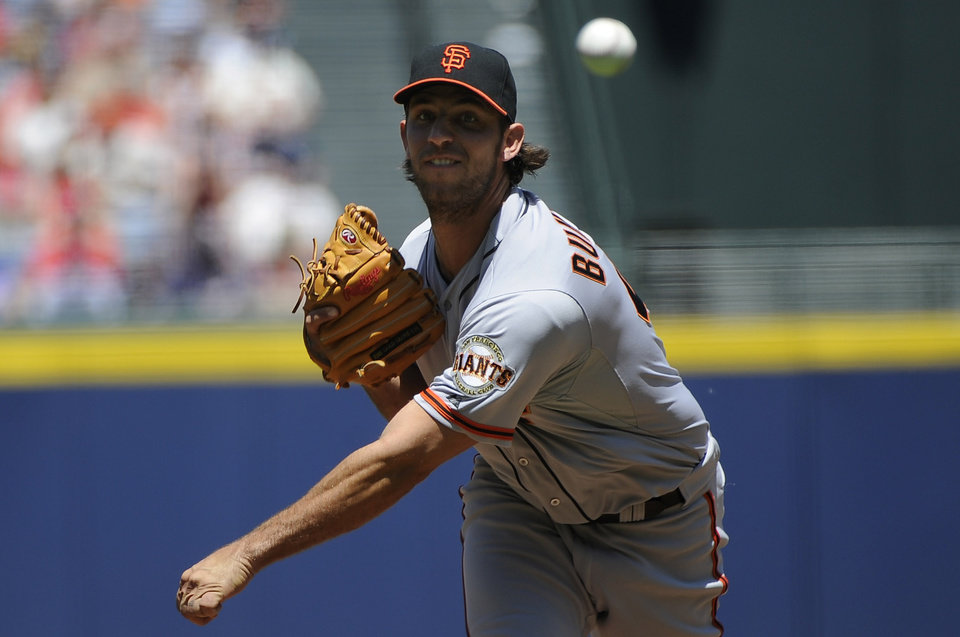 Photo - San Francisco Giants starting pitcher Madison Bumgarner delivers to the Atlanta Braves during the first inning of a baseball game on Sunday, May 4, 2014, in Atlanta. (AP Photo/David Tulis)