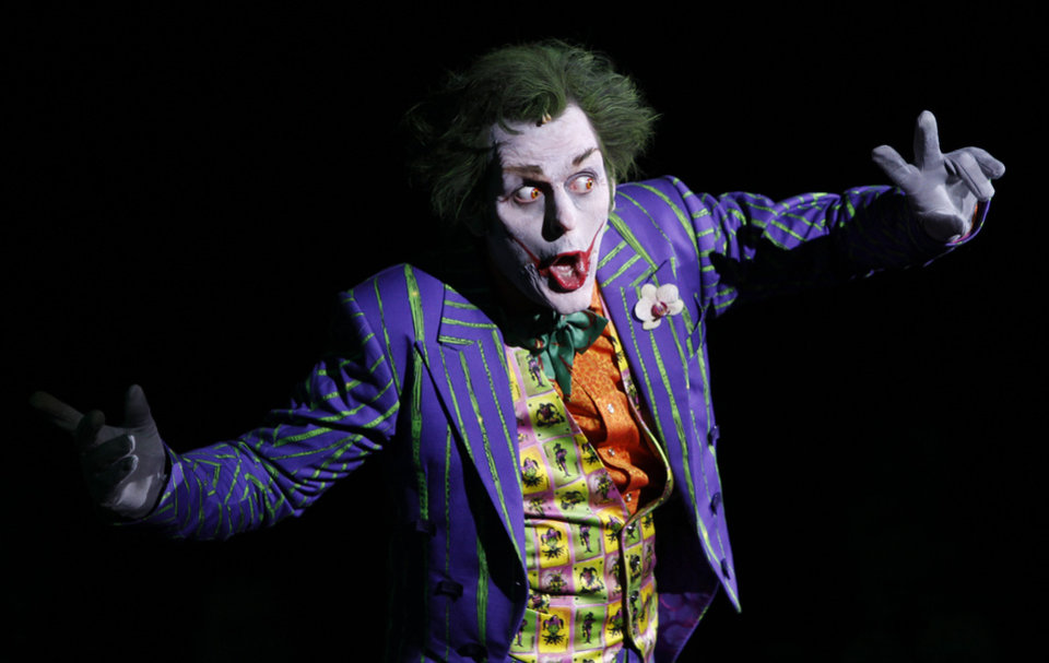 Photo - Garry Lake who plays the Joker, performs on stage to launch the Batman Live Tour in central London, Tuesday 12 April 2011, which tours arenas across the UK and Europe beginning in Summer 2011, and arrives in North America in August 2012. Combining acrobatics, stunt work and illusions, the adventures of Batman and Robin are brought to life on stage for the first time in the characters history.(AP Photo/Joel Ryan)
