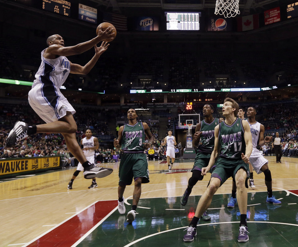 Photo - Orlando Magic's Arron Afflalo goes up for a shot during the first half of an NBA basketball game against the Milwaukee Bucks Sunday March 17, 2013, in Milwaukee. (AP Photo/Morry Gash)