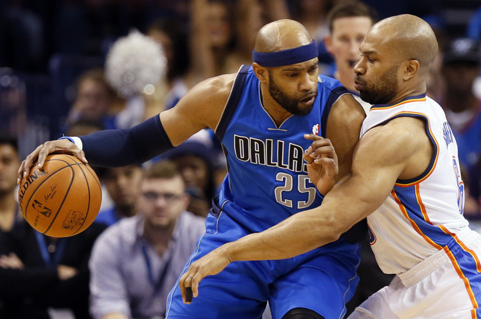 Photo - Dallas' Vince Carter (25) works against Oklahoma City's Derek Fisher (6) during an NBA basketball game between the Oklahoma City Thunder and the Dallas Mavericks at Chesapeake Energy Arena in Oklahoma City, Sunday, March 16, 2014. Photo by Nate Billings, The Oklahoman
