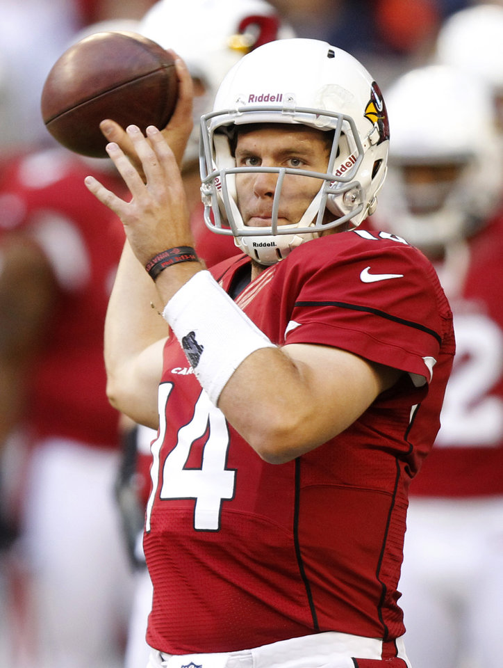 Photo - Arizona Cardinals quarterback Ryan Lindley (14) warms up prior to an NFL football game against the Chicago Bears, Sunday, Dec. 23, 2012, in Glendale, Ariz. (AP Photo/Paul Connors)