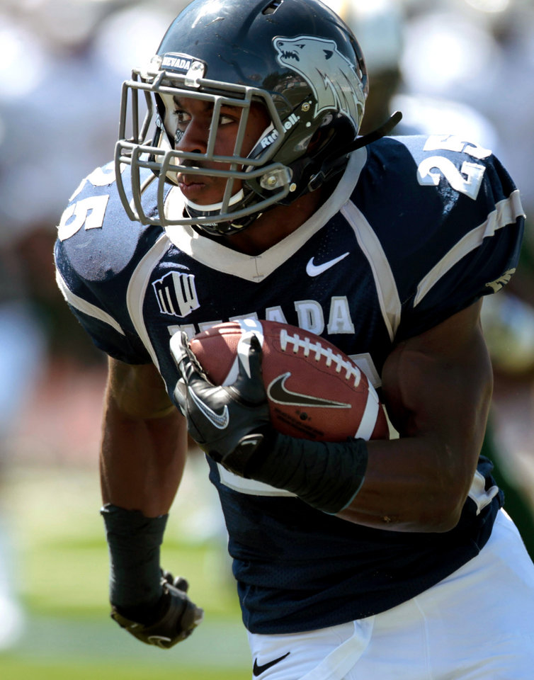 Photo -   Nevada's Stefphon Jefferson (25) runs against South Florida during the first half of an NCAA college football game Saturday, Sept. 8, 2012, in Reno, Nev. (AP Photo/Cathleen Allison)
