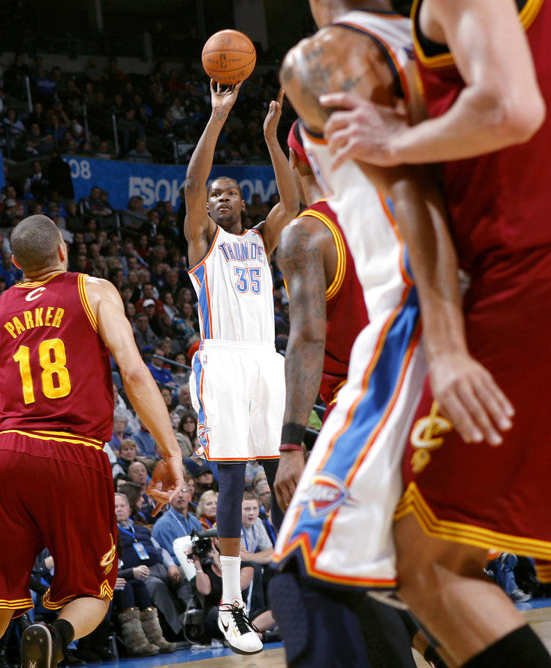 Photo - Oklahoma City's Kevin Durant takes a shot against Cleveland during the first half of their NBA basketball game at the OKC Arena in Oklahoma City on Sunday, Dec. 12, 2010. Photo by John Clanton, The Oklahoman