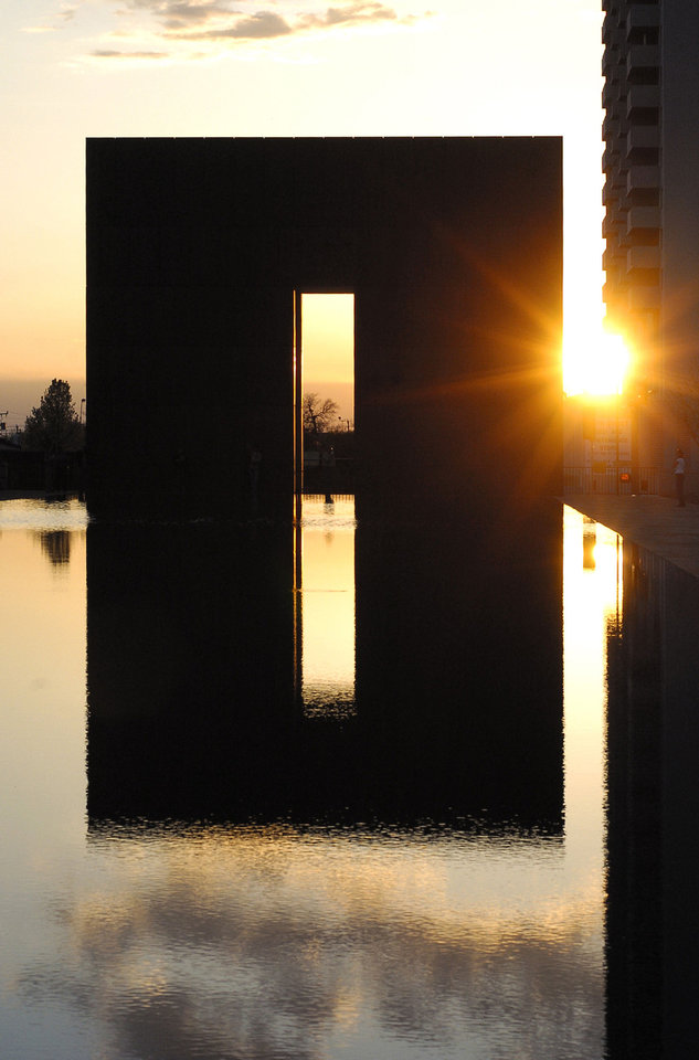 Sunset falls behind the 9:03 gate at the Oklahoma City National Memorial, Wednesday, March 30, 2005. By Bill Waugh/The Oklahoman