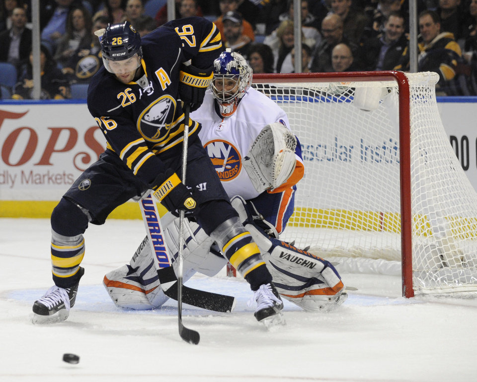 Photo - Buffalo Sabres' left winger Thomas Vanek (26), of Austria, gets ready to deflect the puck in front of New York Islanders' goaltender Evgeni Nabokov (20), of Russia, during the first period of an NHL hockey game in Buffalo, N.Y., Saturday, Feb. 23, 2013. (AP Photo/Gary Wiepert)