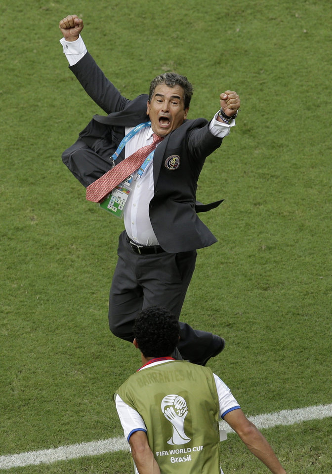 Photo - Costa Rica's head coach Jorge Luis Pinto celebrates after winning the group D World Cup soccer match between Italy and Costa Rica at the Arena Pernambuco in Recife, Brazil, Friday, June 20, 2014. Costa Rica beat four-time champion Italy 1-0 to secure a spot in the next round. (AP Photo/Hassan Ammar)