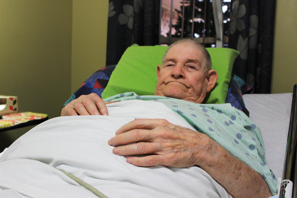 Photo - Bob Littlejohn, a 77-year-old Oklahoma City resident, lies in his bed in his south Oklahoma City home.
