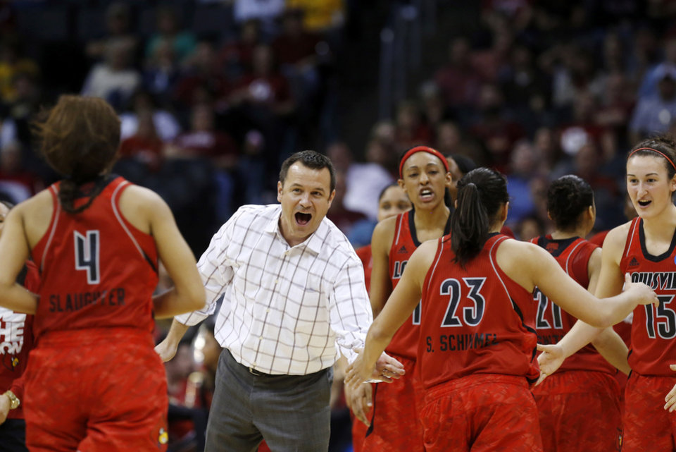 Louisville head coach Jeff Walz greets his players as they run back to the bench during a timeout in the second half of a regional semifinal game against Baylor in the women's NCAA college basketball tournament in Oklahoma City, Sunday, March 31, 2013. Louisville won 82-81. (AP Photo/Sue Ogrocki) ORG XMIT: OKSO124