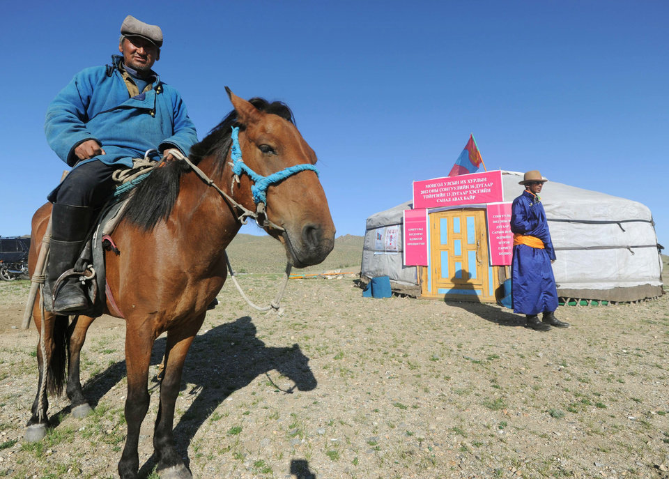 Photo -   A nomad voter arrives at a yurt temporarily serving as a polling station in Hovt, western Mongolia, Thursday, June 28, 2012. Mongolians are voting for a new legislature, going to the polls by foot, car and even horse for an election centered on how best to distribute the benefits of Mongolia's mining boom. (AP Photo/Kyodo News) JAPAN OUT, MANDATORY CREDIT, NO LICENSING IN CHINA, HONG KONG, JAPAN, SOUTH KOREA AND FRANCE