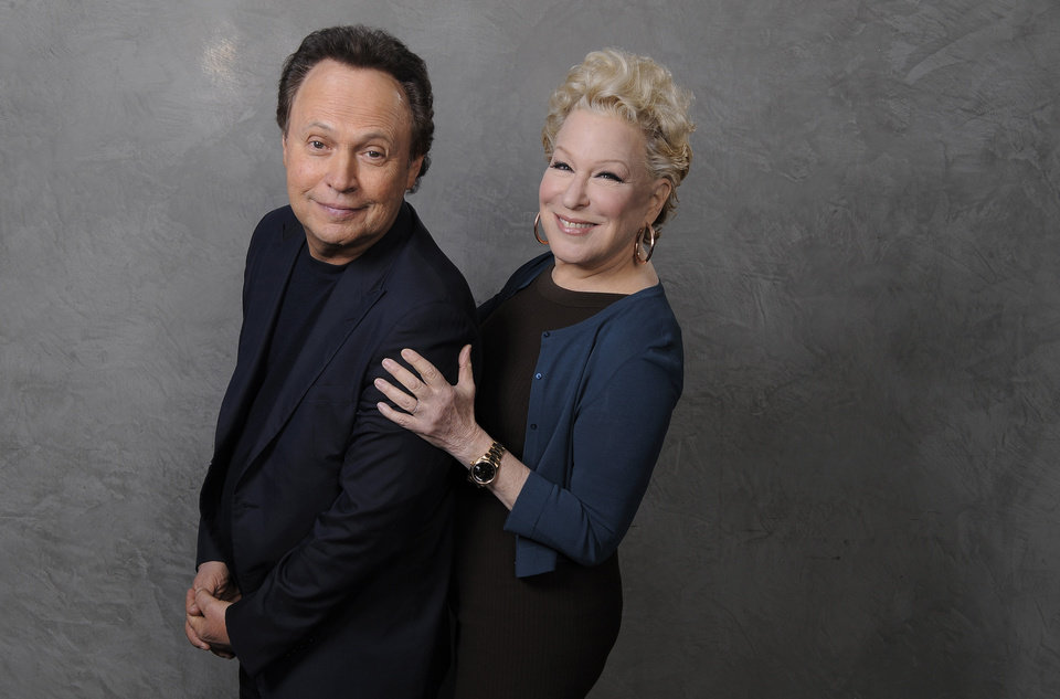"In this Saturday, Dec. 15, 2012 photo, Billy Crystal, left, and Bette Midler, cast members in the film ""Parental Guidance,"" pose together for a portrait at the Ritz Carlton Hotel in Los Angeles. Longtime friends Crystal and Midler finally share the screen in ""Parental Guidance,"" in theaters Christmas Day. (Photo by Chris Pizzello/Invision/AP)"