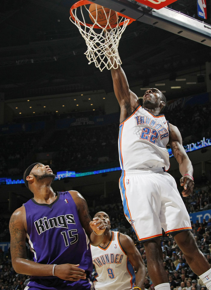 Photo - Oklahoma City's Jeff Green (22) scores a basket over DeMarcus Cousins (15) of Sacramento during the NBA basketball game between the Sacramento Kings and the Oklahoma City Thunder at the Oklahoma City Arena in Oklahoma City, Friday, December 17, 2010. The Thunder won, 102-87. Photo by Nate Billings, The Oklahoman