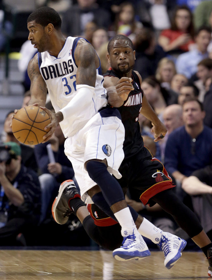 Dallas Mavericks guard O.J. Mayo (32) drives against Miami Heat guard Dwyane Wade (3) during the first quarter of an NBA basketball game, Thursday, Dec. 20, 2012, Dallas. (AP Photo/LM Otero)