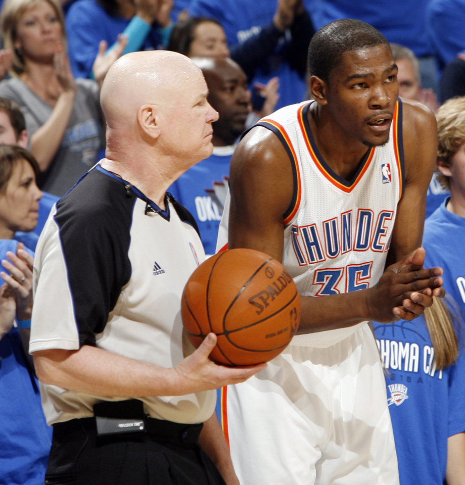 Photo - Oklahoma City's Kevin Durant (35) talks to official Joe Crawford in the second half during game one of the Western Conference semifinals between the Memphis Grizzlies and the Oklahoma City Thunder in the NBA basketball playoffs at Oklahoma City Arena in Oklahoma City, Sunday, May 1, 2011. Memphis won, 114-101. Photo by Nate Billings, The Oklahoman