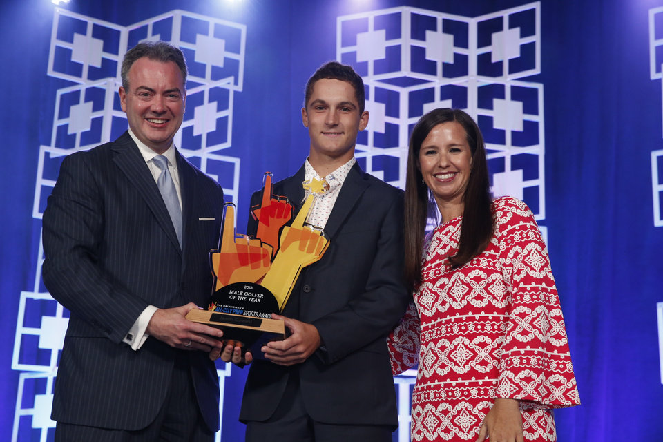 Photo - Oklahoman Publisher Chris Reen and sports columnist Jenni Carlson present the male golfer of the year award to Jaxon Dowell at the Oklahoman's All-City Prep Sports Awards, celebrating top high school athletes, at the Cox Convention Center on Tuesday, June 26, 2018 in Oklahoma City, Okla.  Photo by Steve Sisney, The Oklahoman