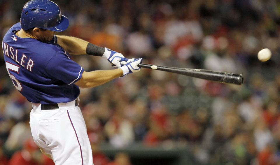Texas Rangers' Ian Kinsler swings at a fifth-inning pitch during the Rangers' exhibition baseball game against the Mexico City Red Devils on Thursday, March 28, 2013, in Arlington, Texas. (AP Photo/Fort Worth Star-Telegram, Brandon Wade)