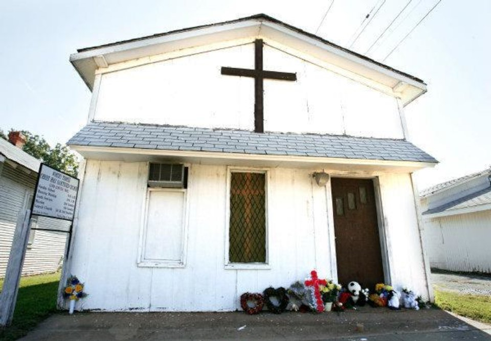Flowers, stuffed animals and mementos are placed at the entrance to the church where The Rev. Carol Daniels was killed on Aug. 23. The building was torn down in July and a permanent memorial will be erected on the site. FILE PHOTO <strong>Steve Sisney - The Oklahoman</strong>