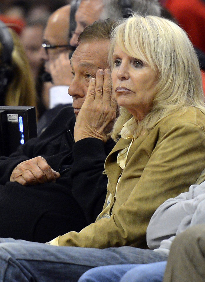 Photo - FILE - In this May 19, 2012, file photo, Los Angeles Clippers owner Donald Sterling, left, and his wife Rochelle watch during the second half in Game 3 of an NBA basketball playoffs Western Conference semifinal against the San Antonio Spurs in Los Angeles. An attorney representing the estranged wife of Clippers owner Donald Sterling said Thursday, May 8, 2014, that she will fight to retain her 50 percent ownership stake in the team. (AP Photo/Mark J. Terrill)
