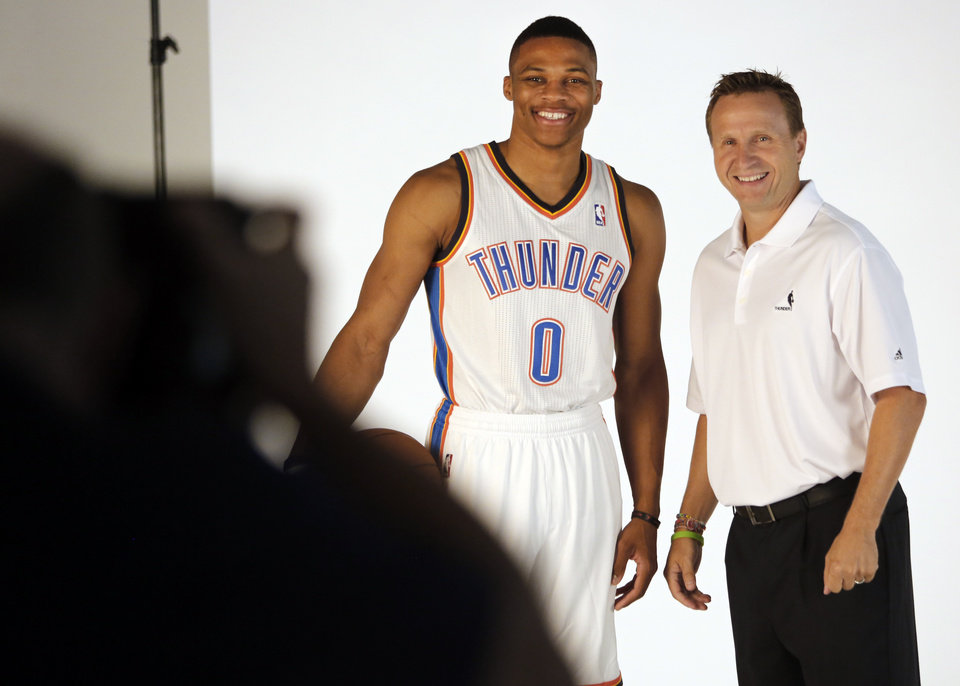 Russell Westbrook and coach Scott Brooks pose for photos during media day with the Oklahoma City Thunder in Oklahoma City, Thursday September  27, 2013. Photo By Steve Gooch, The Oklahoman