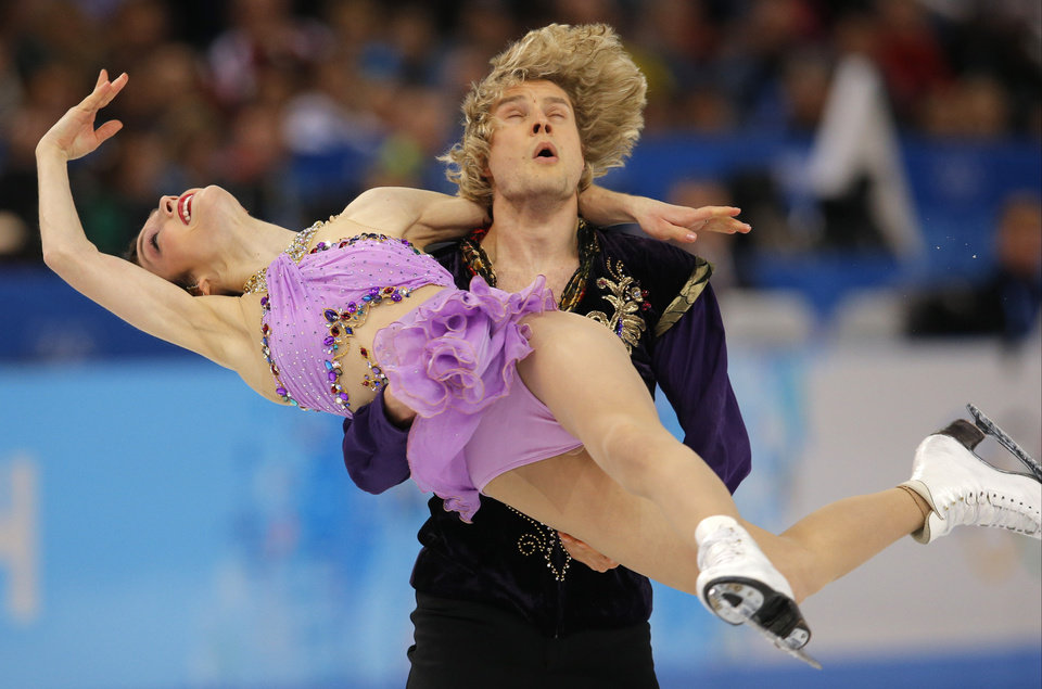 Photo - Meryl Davis and Charlie White of the United States compete in the ice dance free dance figure skating finals at the Iceberg Skating Palace during the 2014 Winter Olympics, Monday, Feb. 17, 2014, in Sochi, Russia. (AP Photo/Vadim Ghirda)