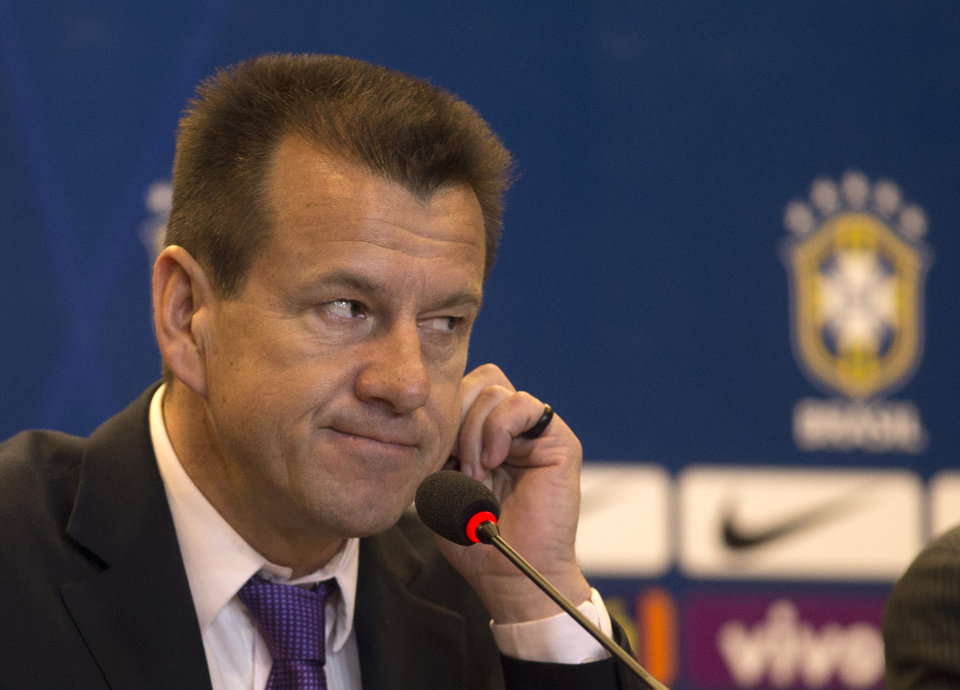 Photo - Brazil's soccer coach Dunga listens to a question during a press conference in Rio de Janeiro, Brazil, Tuesday, Aug. 19, 2014. Dunga summoned players for upcoming friendly games against Colombia and Ecuador, the first time he picked players since taking over the national team from Luiz Felipe Scolari after the World Cup. (AP Photo/Silvia Izquierdo)