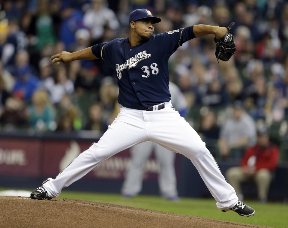 Photo - Milwaukee Brewers starting pitcher Wily Peralta throws to the Chicago Cubs during the first inning of a baseball game on Sunday, April 27, 2014, in Milwaukee. (AP Photo/Jeffrey Phelps)