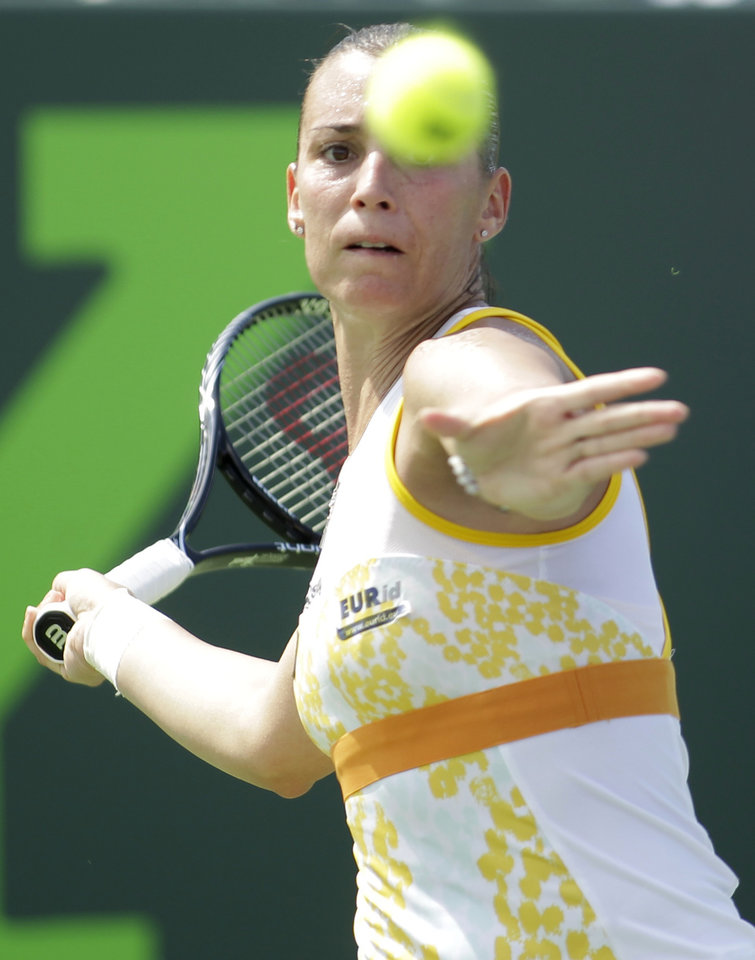Photo - Flavia Pennetta, of Italy, returns the ball to Ana Ivanovic, of Serbia, during the Sony Open tennis tournament, Saturday, March 22, 2014, in Key Biscayne, Fla. (AP Photo/Luis M. Alvarez)