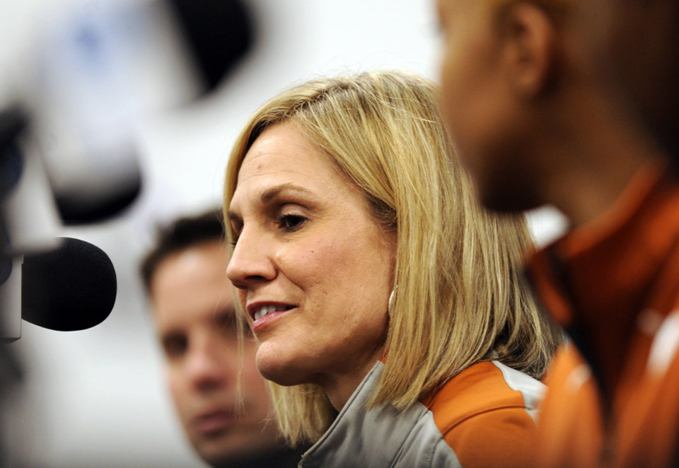 Photo - Texas head coach Karen Aston answers questions during a news conference at the NCAA women's college basketball tournament, Saturday, March 22, 2014. in College Park, Md. Texas plays Pennsylvania in first-round game on Sunday. (AP Photo/Gail Burton)