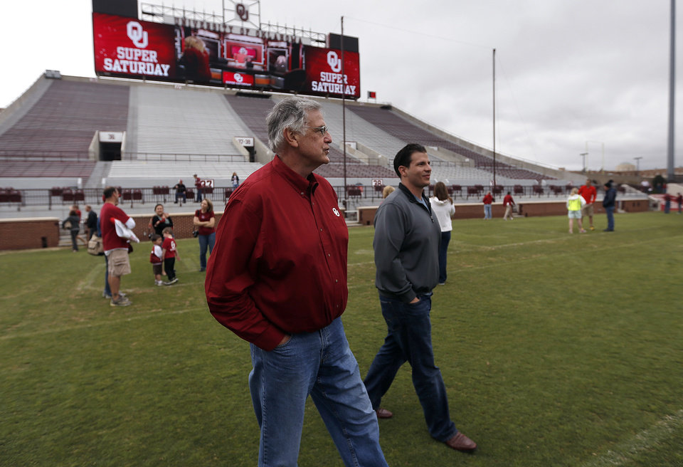 Photo - Kent Deligans walks on Owen Field with his son, Ryan Deligans during a tour of the University of Oklahoma football facilities in Norman, Okla., Saturday, April 27, 2013. Photo by Sarah Phipps, The Oklahoman