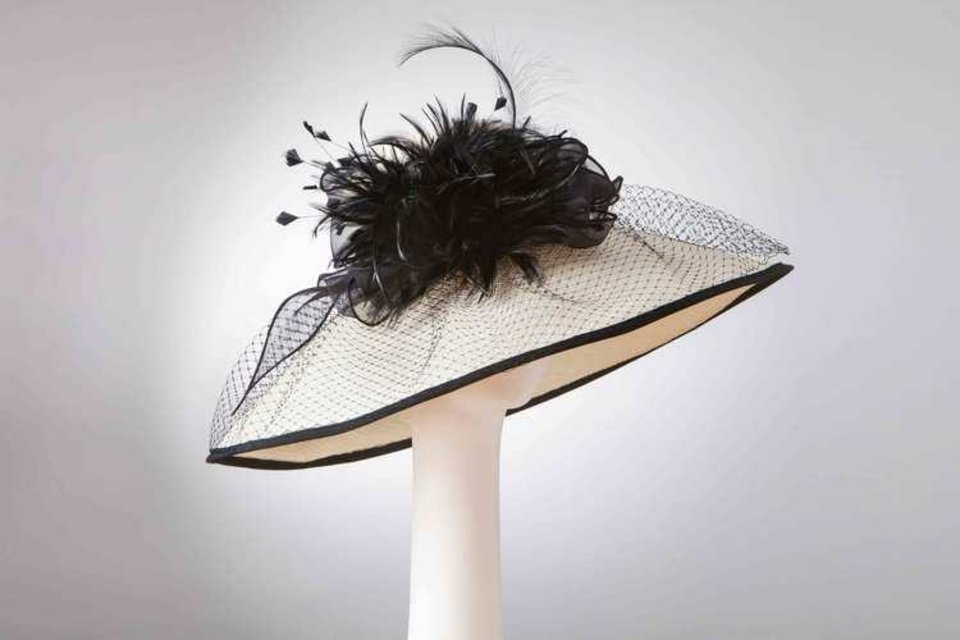 Photo - Brimmed hat with ribbon edge and band, silk organza bow and feathers by Jill Courtemanche. [Photo Provided]