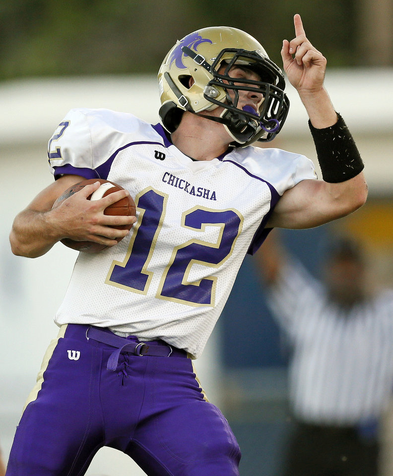 Chickasha's Cade Morris (12) reacts after rushing for a touchdown during a high school football game between Chickasha and Capitol Hill at Star Spencer's Carl Twidwell Stadium in Spencer, Okla., Thursday, Oct. 3, 2013. Photo by Nate Billings, The Oklahoman