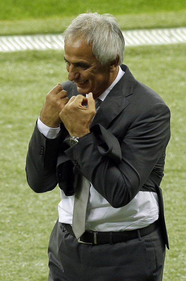Photo - Algeria's head coach Vahid Halilhodzic reacts during the World Cup round of 16 soccer match between Germany and Algeria at the Estadio Beira-Rio in Porto Alegre, Brazil, Monday, June 30, 2014. (AP Photo/Thanassis Stavrakis)