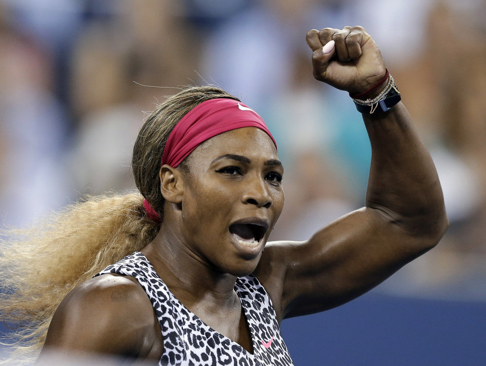 Photo - Serena Williams, of the United States, gestures after defeating Flavia Pennetta, of Italy, 6-3, 6-2 in the quarterfinals of the U.S. Open tennis tournament Wednesday, Sept. 3, 2014, in New York. (AP Photo/Darron Cummings)