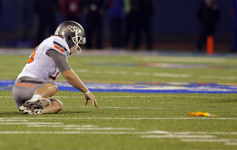 Oklahoma State's Quinn Sharp (13) gets up off the turf after a roughing the kicker penalty during the college football game between Oklahoma State University (OSU) and the University of Kansas (KU) at Memorial Stadium in Lawrence, Kan., Saturday, Oct. 13, 2012. Photo by Sarah Phipps, The Oklahoman