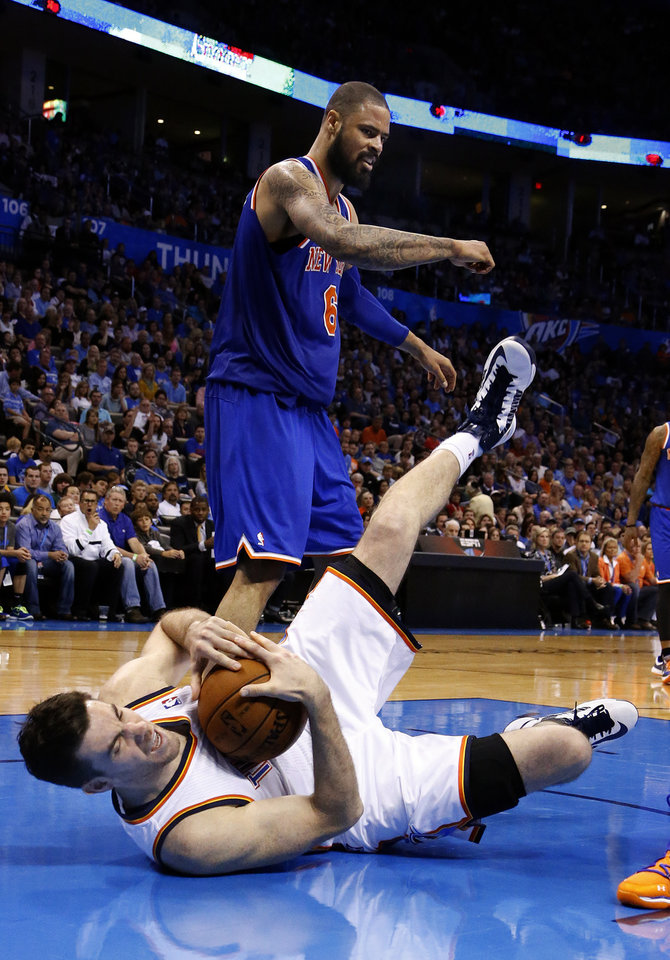 Photo - Oklahoma City's Nick Collison (4) falls to the ground after fouling New YorK's Tyson Chandler (6) during NBA basketball game between the Oklahoma City Thunder and the New York Knicks at the Chesapeake Energy Arena, Sunday, April 7, 2010, in Oklahoma City. Photo by Sarah Phipps, The Oklahoman