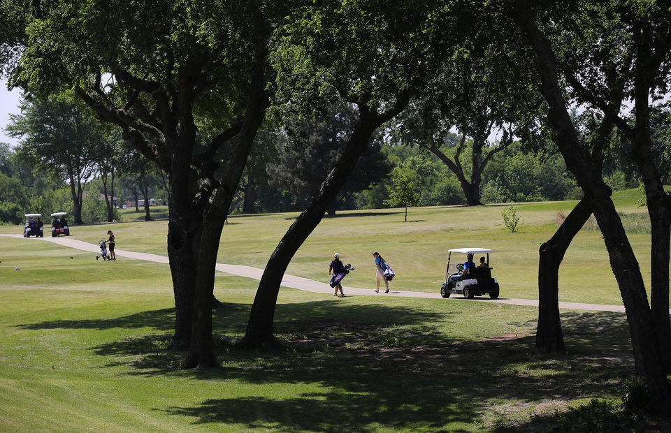 Photo - Competitors on the course during the 2014 Class 2A girls' golf state championship tournament  Wednesday, May 7, 2014, at Trosper Golf Course in Del City.  Photo by Jim Beckel, The Oklahoman