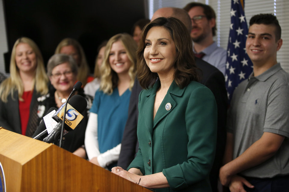 Photo -  State schools Superintendent Joy Hofmeister speaks Tuesday during a news conference over the dismissal of her criminal case. [Photo by Bryan Terry, The Oklahoman]