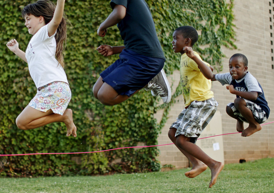 Autumn Squire, 11, at left, jumps rope with brothers Donta Jones, 7, and Sonoa Jones, 5, at right, during Jazz on the Lawn at the Ralph Ellison Library on Tuesday, September 4, 2012. Photo by Bryan Terry, The Oklahoman