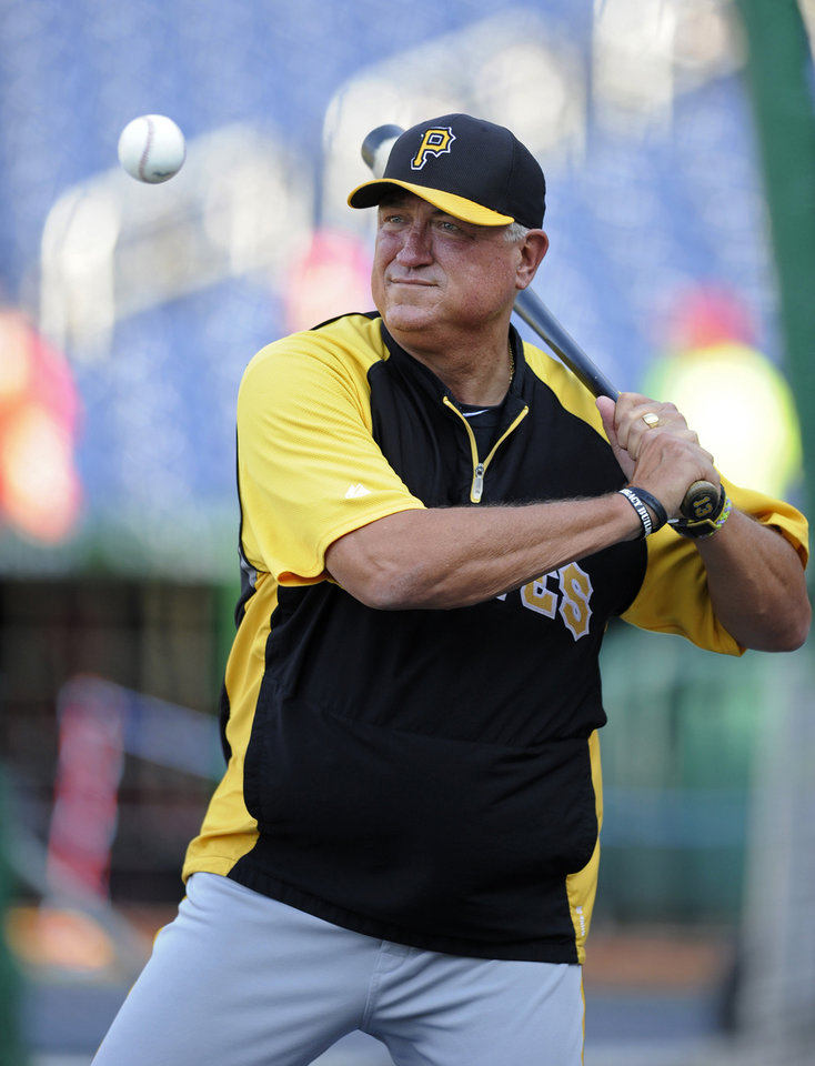 Photo - In this July 23, 2013, photo, Pittsburgh Pirates manager Clint Hurdle hits balls during batting practice before the Pirates' baseball game against the Washington Nationals in Washington. Hurdle has won the NL Manager of the Year award after guiding the Pirates to the playoffs in their first winning season since 1992. (AP Photo/Nick Wass)