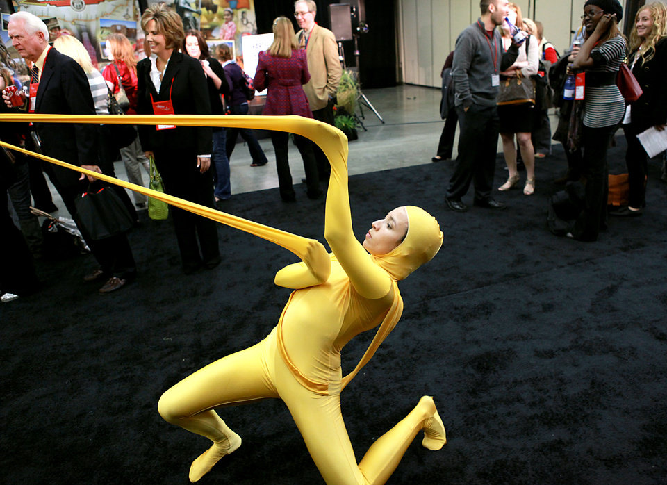 Photo - Thyrsa Da Rosa Hartel, a member of the Hartel Dance Studio in Oklahoma City, performs with the group in front of visitors at the Creativity World Forum at the Cox Convention Center in downtown Oklahoma City on Tuesday, Nov. 16, 2010. This dance is inspired by the sculpture Ikrausim by artist Nick Ervinck. Photo by John Clanton, The Oklahoman