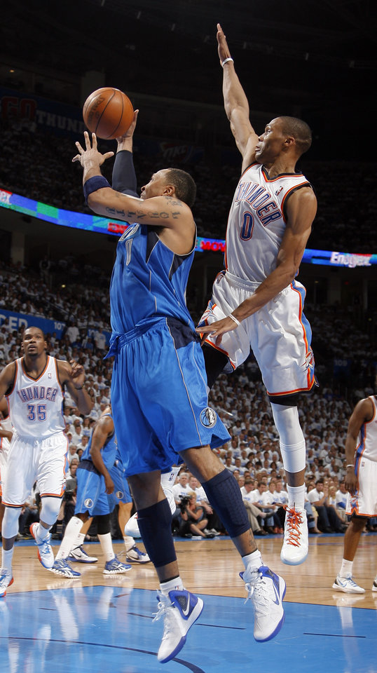 Photo - Oklahoma City's Russell Westbrook (0) defends against Dallas' Shawn Marion (0) during Game 2 of the first round in the NBA basketball playoffs between the Oklahoma City Thunder and the Dallas Mavericks at Chesapeake Energy Arena in Oklahoma City, Monday, April 30, 2012. Photo by Sarah Phipps, The Oklahoman