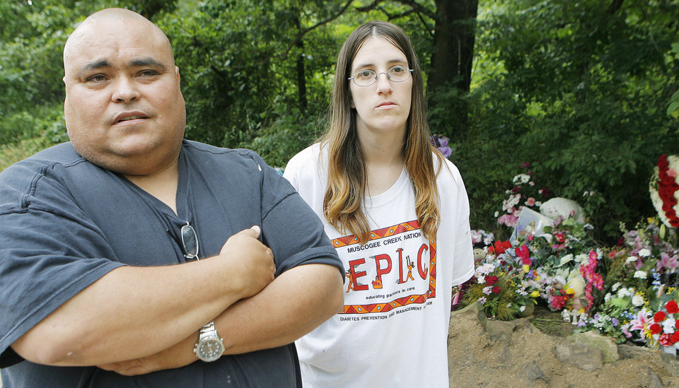 Photo - MURDERS, SHOOTING DEATHS, TAYLOR PLACKER, TAYLOR DAWN PASCHAL-PLACKER , SKYLA JADE WHITAKER, WELEETKA, NELSON HARJO: Nelson and Elizabeth Harjo stop by the memorial for Taylor Paschal-Placker and her friend  Skyla Whitaker, Monday, June 16, 2008.  The girls were murdered while walking on a dirt road near one of their homes  Photo by David McDaniel/The Oklahoman     ORG XMIT: KOD